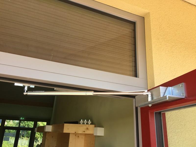Open door with overhead door closer and back check