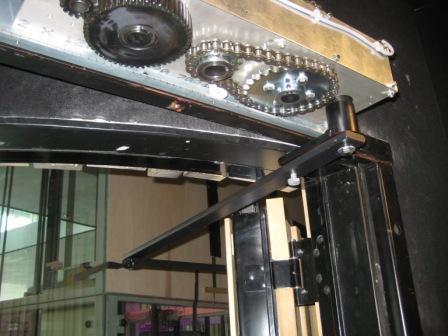 Door operator on hinged fire door